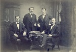 "Four unidentified men pose for a studio portrait.  Photo is mounted on 8"" x 10"" heavy board."